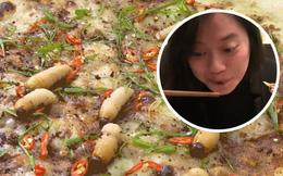 Đang 'chén' ngon lành món đuông dừa, cô gái bất ngờ bị món ăn quay ra cắn vào môi