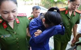 [ẢNH] Cô gái mua trà sữa đầu độc chị họ ở Thái Bình dùng tay che kín mặt khi đến toà