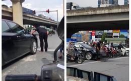 Dừng đèn đỏ, người đàn ông bước xuống từ ô tô và có hành động khiến cả phố hoảng hốt, xấu hổ thay