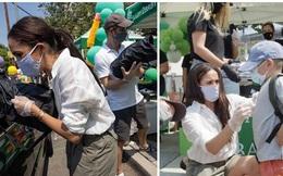 Vợ chồng Meghan Markle xuống đường phát đồ từ thiện nhưng bị mỉa mai vì mang theo nhiếp ảnh gia riêng để chụp ảnh