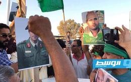 """Libya """"nóng"""": Người dân xuống đường biểu tình, ủng hộ con trai ông Gaddafi tái xuất chính trường"""