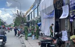 Công an đưa nghi can gây cháy chi nhánh ngân hàng Eximbank ở Sài Gòn tới hiện trường thực nghiệm