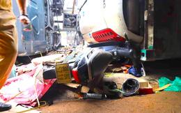 Đâm vào xe máy cắt ngang đường, xe container lật tiếp vào nhà dân khiến 2 người thương vong
