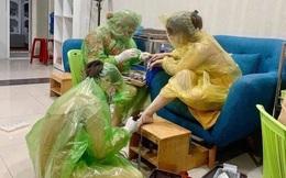 Xôn xao bức ảnh mặc áo mưa làm móng giữa thời dịch bệnh: Nóng nực, kín mít, chỉ hở vài lỗ