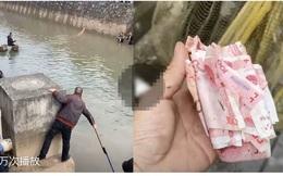 Thấy cả đống tiền trôi nổi dưới sông, người dân tranh nhau vớt: Nguồn gốc số tiền cảnh tỉnh nhiều người
