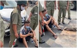 """Lái ô tô vi phạm, Youtuber Lê Chí Thành ngồi trước đầu xe yêu cầu công an làm đúng: """"Đưa hợp đồng cẩu xe ra đây"""""""
