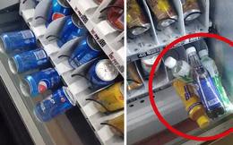 Khoảnh khắc xui xẻo không ai muốn gặp khi mua nước ở máy bán hàng tự động: Ức chế phát điên mà không làm gì nổi!