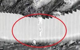 Video kẻ buôn người thả trẻ nhỏ từ rào cao 4m để vào đất Mỹ
