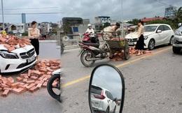 Xe xích lô chế chở gạch tông móp đầu Mercedes, nữ tài xế khoanh tay bất lực nhìn hiện trường