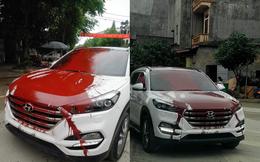 """Hình ảnh ô tô trắng bị vấy sơn đỏ khắp thân xe khiến các diễn đàn mạng """"sôi sục"""" trong ngày cuối tuần"""