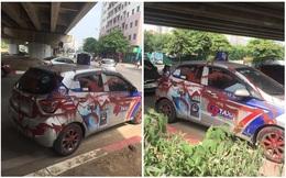 """Đỗ dưới gầm cầu, taxi G7 bị phun sơn kín thân xe: Tài xế nhìn mà """"khóc thét"""""""