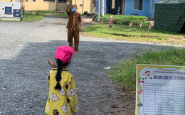 """Bé gái 7 tuổi 2 lần vẫy tay chào ông ngoại ở khu cách ly: Lời nhắn nhủ khiến bao người """"cay mắt"""""""