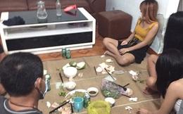 Được 3 nữ nhân viên nhà nghỉ mời, 2 thanh niên vào nhậu cùng thì bị công an bắt quả tang