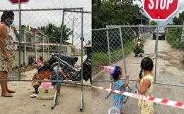Chiến sĩ CA thổi nến mừng sinh nhật con gái ngay tại hàng rào phong tỏa, cái vẫy tay từ xa khiến bao người thổn thức