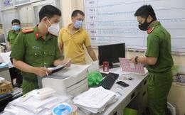 Bắt giam cán bộ phường dàn xếp, thu tiền tiêm vắc xin ngừa COVID-19