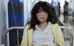 Ảnh TG ấn tượng nhất 2013: Thiếu nữ TQ đờ đẫn vì thiên tai