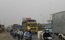 TPHCM: Cho xe gắn máy đi vào làn ô tô để giảm ùn tắc