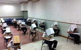 """Thái Lan: Sinh viên tình nguyện đội """"hộp giấy"""" để tránh gian lận"""