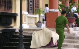 Bộ Tư pháp làm rõ vụ cụ bà tự thiêu trước cổng TAND