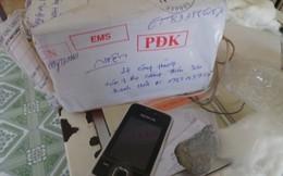 Chuyển phát nhanh qua bưu điện, iphone 5 thành... cục đá