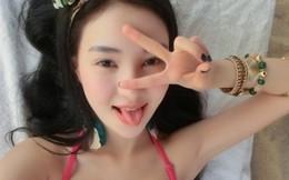 Hot girl tai tiếng Trung Quốc khoe ảnh sexy bên bãi biển