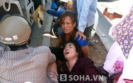2 chị khóc ngất chứng kiến em gái nằm bất động dưới bánh xe ben