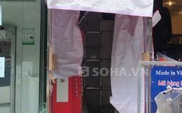 Cảnh sát khám nghiệm máy ATM của Maritime Bank bị trộm đục phá