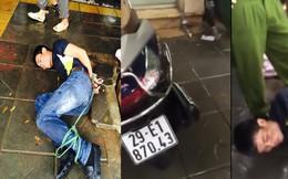 Tên trộm bị dân đá lăn quay và trói cạnh chiếc xe máy