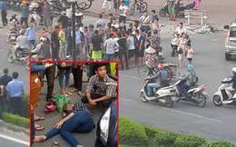 Cắt ống quần cô gái bị gãy chân giữa đường để cấp cứu
