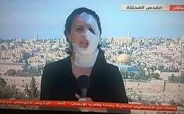 Nữ phóng viên vẫn lên sóng dù trúng mảnh lựu đạn Israel vào mặt