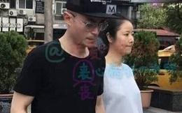 Bà bầu Lâm Tâm Như nắm chặt tay chồng dạo bước trên phố
