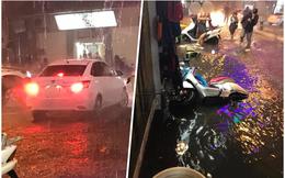 Trong tối Hà Nội mưa lớn, hành động của xe ô tô khiến bao người khốn đốn
