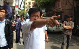 Ông Đoàn Ngọc Hải bị xô đẩy trong lúc chỉ đạo đập bỏ trụ sở khu phố