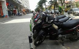 """Hà Nội: """"Chiến dịch"""" đòi vỉa hè vừa lắng, quận Hoàng Mai cho doanh nghiệp kẻ vạch trông xe?"""