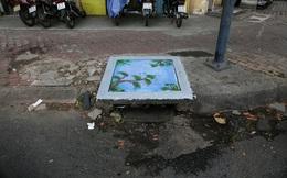 Nhìn những bức tranh trên nắp cống ở Sài Gòn đẹp như thế này, không ai nỡ xả rác nữa!