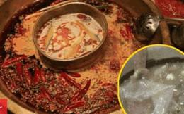 Đang ăn lẩu, cô gái kinh hoàng phát hiện bao cao su nằm chình ình trong nồi