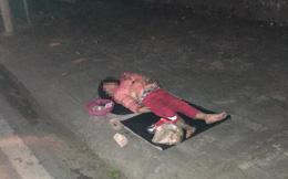 Bé gái 5 tuổi ăn xin ngủ vỉa hè trong đêm lạnh: Không để bé bị lạm dụng đi nuôi gia đình