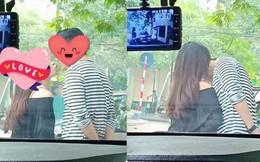 Ngồi trong ô tô chụp trộm đôi nam nữ ôm hôn thắm thiết, người đàn ông gây tranh cãi
