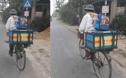 Bố đèo con nhỏ trên xe đạp, chữ viết phía sau thùng hàng khiến nhiều người nghẹn ngào