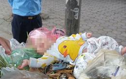 Trước khi bé trai được phát hiện ở thùng rác trên phố Hà Nội, một phụ nữ trên 30 tuổi bế bé, nhận là mẹ