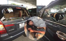 Công an đưa người đàn ông đập phá ô tô, đánh lái xe đi bệnh viện tâm thần