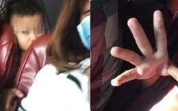 Bàn tay thò lên từ ghế sau trên xe khách và phản ứng của cô gái khiến dân mạng bức xúc