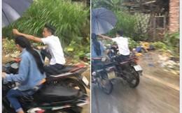 Liều mình che ô cho bạn gái ngày mưa, đã không được khen ga-lăng hay lãng mạn, chàng trai còn bị mắng té tát