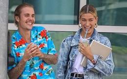 Justin Bieber buộc tóc gọn gàng, nắm tay bạn gái dạo phố ở Los Angeles