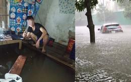 Mưa nhiều ngày ở Nghệ An, nước ngập đến tận giường, đi thuyền trong phố