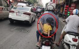 Ông bố đèo con đi viện và hành động của người đi đường khiến tất cả xúc động hơn