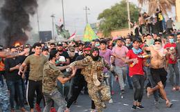 24h qua ảnh: Cảnh sát Iraq tháo chạy khỏi người biểu tình
