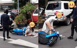 Đụng chạm với xe BMW, cô gái gây chú ý vì thân hình nóng bỏng