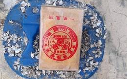 Hàng chục bánh nghi heroin có chữ Trung Quốc tiếp tục trôi dạt vào bờ biển miền Trung