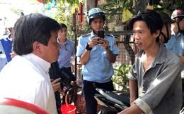 Người dân quận 1 ôm chó chạy vào nhà đóng cửa khi thấy ông Đoàn Ngọc Hải